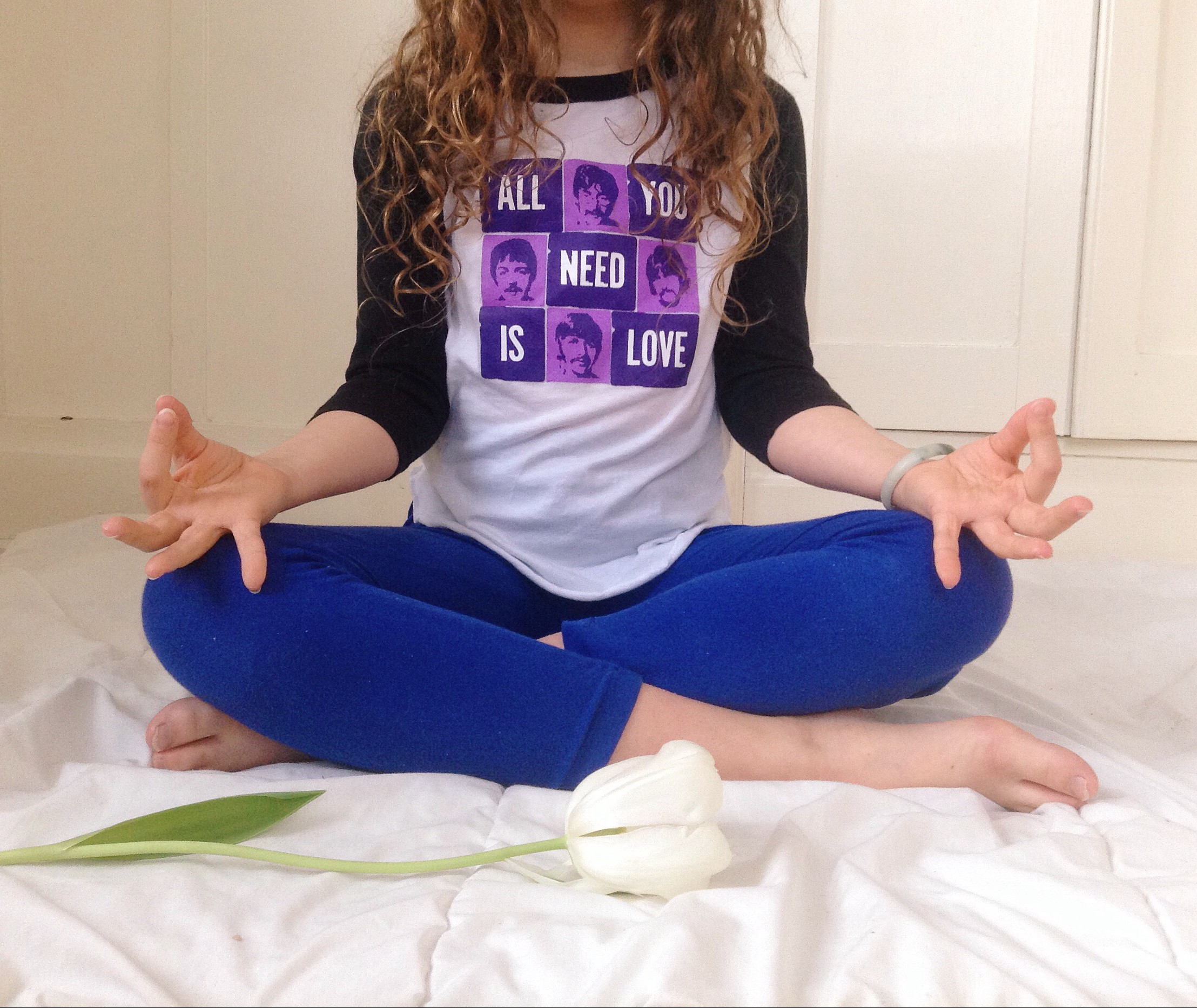 "Ro practicing the Sa Ta Na Ma meditation. Raglan ""All You Need is Love"" tee by Pop Kids USA."