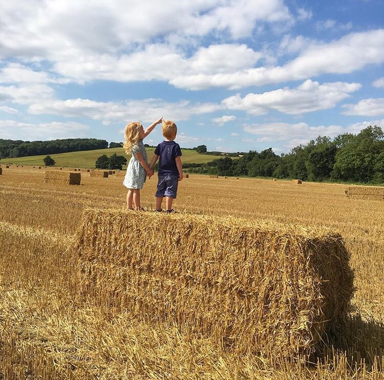 Slow Living Project siblings on hay stack